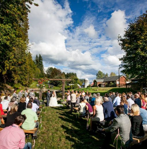 Ceremony by the Pond with Barn in Background